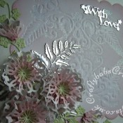 Card made using the Tattered Lace Venetian Fern die, die cut used to deboss background with versamark ink which is then heat embossed with iridescent clear embossing powder and inked with distress ink. Flowers made using the - Tattered Lace interlocking with love ovals die - (see separate board for step by step flowers), foliage made using Tattered Lace lavish blooms fern leaf, and Tattered Lace mini oriental ivy flourish dies. Sentiments from the Tattered Lace With Love interlocking ovals set - craftybabscreativecrafts.co.uk