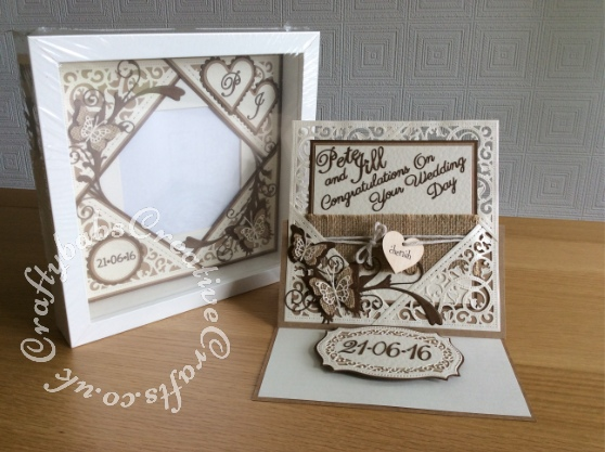 Wedding card and matching photo frame gift made to match wedding invitation using a variety of dies including; Spellbinders gold elements one dies, Labels 25 and majestic labels 25, and Nesting plain and scalloped hearts dies, Memory Box Gwyneth flourish and Levenworth and Cascadia butterfly trio dies, Cheery Lynn delicate lace script dies, Britannia sentiment die,Tattered Lace 'A Date To Remember' dies, Quickutz Nesting plain and scalloped circle dies. and spellbinders les papillions die. Hessian butterflies were shop bought. Hessian ribbon, string & wooden heart were on wedding invitation, rub on transfers applied to both sides of wooden heart - craftybabscreativecrafts.co.uk