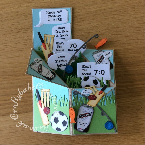 Cricket, Fishing, Football Men Pop Up Card made using a variety of dies including; Quickutz cookie cutter soda can and nesting circles (smallest one for cricket ball) die, 2x2 single cutz cricket die, 2x2 double cutz football die, Go Kreate boo bear fishing die, Xcut scene grass and trees border dies, Memory box golf landscape die and Tattered Lace panorama trees die - craftybabscreativecrafts.co.uk