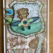 "1st Birthday Card for a little boy, made using Trimcraft's Tiny Tatty Teddy 3d dies and matching 12""x12"" papers. Also using Marianne sentiment dies and Sizzix sizzlits Fruit Smoothie alphabet dies - craftybabscreativecrafts.co.uk"