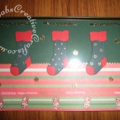 Acetate overlay Christmas card made using peel offs and Sizzix originals stocking die. - craftybabscreativecrafts.co.uk