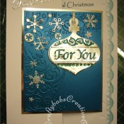 Bauble & Snowflake Christmas card mad using Cuttlebug 2x2 snowflakes die, Britannia dies Happy Christmas sentiment, cuttlebug 3x3 cut and emboss for you ornament set and cuttlebug snowflake corner scrolls embossing folder. - craftybabscreativecrafts.co.uk