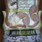 Large Butterfly Easel birthday card made using various dies including; Memory box Tristan, Chloe, Pippi and Isabella dies, My Favourite things Dainty bows dies, Britannia dies Happy Birthday Daughter sentiments dies, Cheery Lynn reflections boutique pearl french flair dies and flourishes from the Marianne scalloped circle frame die set. - craftybabscreativecrafts.co.uk