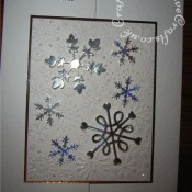 Embossed snowflake Christmas card made using Cuttlebug snowflake embossing folder, Xcut snowflake punch and Sizzix sizzlits snowflake dies. - craftybabscreativecrafts.co.uk