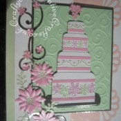 Embossed wedding Cake Wedding Card made using various dies including; Marianne creatables flowers 2 dies, Marianne frame and swirls set flourish dies, Cuttlebug frills and with love border embossing folders and Cuttlebug divine swirl embossing folder. - craftybabscreativecrafts.co.uk