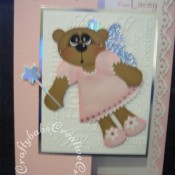 Fairy Bear Christmas card made using Craftycat custom made wooden New Bear die, Toffee Bear outfit die, Quickutz holiday words embossing folder and Cuttlebug 3x3 cut & emboss butterfly die set - craftybabscreativecrafts.co.uk