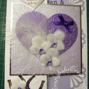 Feathers & Orchids Wedding card. Orchids hand cut and embossed in parchment, Dies used include Sizzix originals Hearts dies, cuttlebug divine swirl embossing folder and Quickutz Horseshoe die. - craftybabscreativecrafts.co.uk