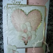 Feathers & Orchids Wedding card. Orchids hand cut and embossed in parchment, Dies used include Sizzix Framelits plain and scalloped Hearts dies, Couture creations intrinsic and tied together embossing folders and Britannia dies wedding day sentiments. - craftybabscreativecrafts.co.uk
