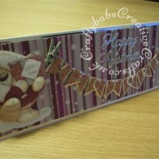 Fizzy Moon Decoupage banner Christmas card made using Fizzy moon decoupage pad, Britannia dies Happy Christmas sentiment dies and Memory Box Alphabet Soup upper case dies - craftybabscreativecrafts.co.uk