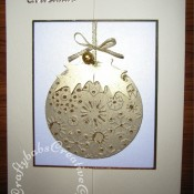 Embossed Bauble Christmas card made using Nesting Circle die, Cuttlebug snowflake embossing folder and woodware large holly leaf punch. - craftybabscreativecrafts.co.uk