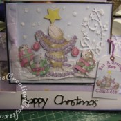 Housemouse Decoupage Stepper Christmas card made using Joanna Sheen's Housemouse CD roms, Spellbinders nesting tags dies, Memory Box Frostyville border die and Marianne Happy Christmas sentiment dies - craftybabscreativecrafts.co.uk