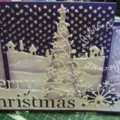 Scenic Stepper Christmas card made using Memory Box Grand merry Christmas die, Memory Box country landscape die, Memory Box Frostyville border die, Memory box Flowering Christmas tree die, Dee's distinctively Christmas Tree stacker, die, and cuttlebug Winter borders embossing folder - craftybabscreativecrafts.co.uk