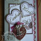 Locket & Keys Wedding card made using Marianne frame swirl flourish die set and Sizzix Bigz Heart Locket die, Memory Box Pippi & Isabella butterfly dies, Britannia dies wedding day sentiment, Cheery Lynn Delicate Lace Alphabet dies, Couture creations Intrinsic embossing folder, Sizzix originals hearts die and Nellie's multi-frame hearts and swans dies. - craftybabscreativecrafts.co.uk