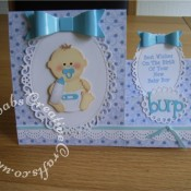 New Baby Boy stepper card using Spellbinders floral ovals dies, My Favourite Things Dainty Bows dies, Go Kreate Burp The Baby die, Tonic Dotty Border punch. - craftybabscreativecrafts.co.uk