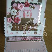 Owl & Floral Easel Birthday Card made using various dies including, Marianne Creatables Happy Birthday sentiment dies, Memory Box Gwyneth Flourish die, My Favourite Things Dainty Bows die, Sizzix Thinlits bunch of flowers dies and La la Land's Pickett heart Fence die - craftybabscreativecrafts.co.uk