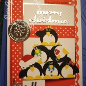 Pile Of Penguins Christmas card made using Woodware circle, flower and bow punches, Cuttlebug 2x2.75 winter jelly embossing folder, Quickutz Holly Jolly gift set dies merry christmas sentiment and Polka dot border die - craftybabscreativecrafts.co.uk