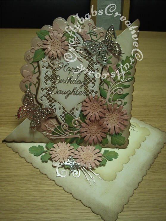 Vintage Style Floral large Easel card made using a variety of dies including Marianne Dies Anja's Large Ovals dies, Spellbinders Les Papillons dies, Kreaxions sunflower dies, Spellbinders shapeabilities Foliage dies, Memory Box Catalina border die and Spellbinders Grand Nestabilities scalloped ovals dies. - craftybabscreativecrafts.co.uk