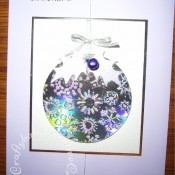Embossed Bauble Christmas card made using Nesting Circle die, Cuttlebug snowflake embossing folder and woodware large holly leaf punch - craftybabscreativecrafts.co.uk