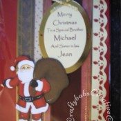 Traditional Santa personalised oval card made using custom made wooden Santa and sack die and Spellbinders Nesting Ovals dies - craftybabscreativecrafts.co.uk
