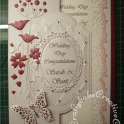 White on White Wedding card with red accents made using Couture creations tied together embossing folder, Spellbinders Papillons dies, Spellbinders small floral ovals die, Spellbinders labels 28 dies, Memory Box Prim Poppy die, Memory Box Tall Chloe stem dies and memory Box honeyblossom twig die - craftybabscreativecrafts.co.uk