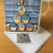 "8""x8"" House-Mouse Cup Cake Easel Card made using Stamped and coloured House-Mouse images, and Quickutz Revolution Cupcake die, Britannia Happy Birthday Sentiment die, Cheery Lynn Delicate Lace Script Alphabet dies, Quickutz nesting scalloped square dies and Cuttlebug 2x2 embossing folder. - craftybabscreativecrafts.co.uk"