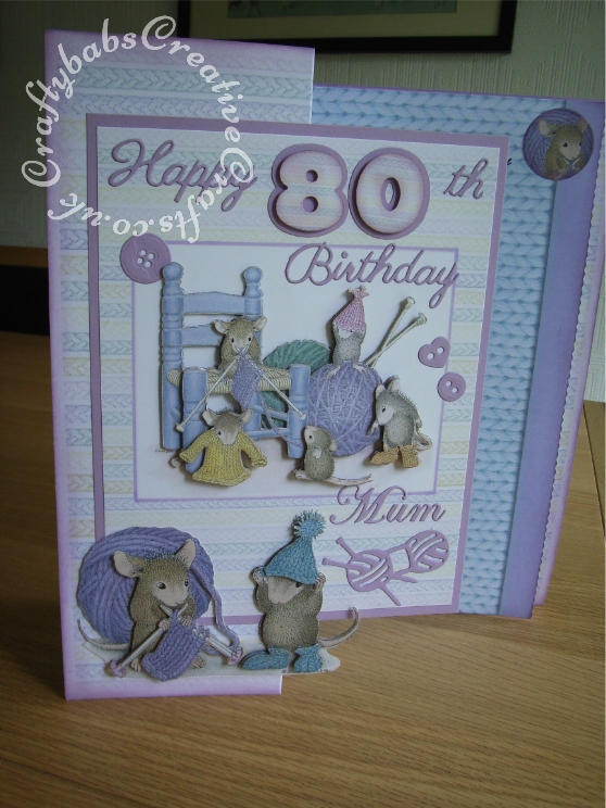 A4 House-Mouse Decoupage 80th Birthday card made using Joanna Sheen House-Mouse CD Roms and various dies including; Sizzix originals numbers dies, Britannia Happy Birthday sentiment dies, Cheery Lynn Delicate Lace Script Alphabet dies, Buttons and knitting dies from X-Cut Haberdashery die set. - craftybabscreativecrafts.co.uk