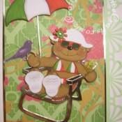 A4 Italian Holiday themed retirement/leaving job card made using mostly custom made wooden dies for bear & hat, Quickutz revolution umbrella die, Quickutz 2x2 martini glass die, Go Kreate Boo bear on holiday die for sunglasses and Cuttlebug Disney cut & emboss set for suitcase. - craftybabscreativecrafts.co.uk