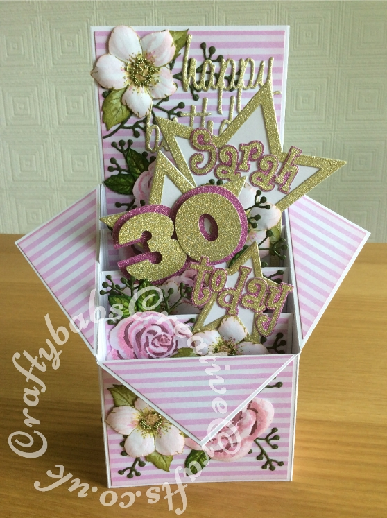 Pop Up Box 30th Birthday card made to co-ordinate with invitation, using a variety of dies including Altenew rose stamp & die set free in issue 149 of Simply Cards & Papercraft, Altenew Christmas rose stamp & die set free with issue 57 of Simply Cards & Papercraft, Sizzix 'Girls Are Wierd' Sizzlits alphabet dies, Sizzix Framelits stars Primitive die set, Sizzix Originals Shadow Box Numbers dies, Sizzix Thinlits Tim Holtz Celebration Words - Script dies and floral sprig dies from The Works. Card use for Matting and layering was printed with background from KanBan Female background papers CD Rom. Nail Caviar applied to centres of Christmas rose flowers and all flowers embossed with ball tools to add dimension. - craftybabscreativecrafts.co.uk
