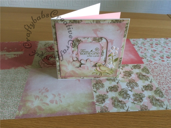 Layered card made from 2 1/4 sheets of 12 x 12 paper, top layer partially die cut using Nellie Snellen nesting Straight dotted square dies, other dies used include Memory Box Botanical Frame die set and Quickutz Limited edition Wild Flower set (for bird). - craftybabscreativecrafts.co.uk