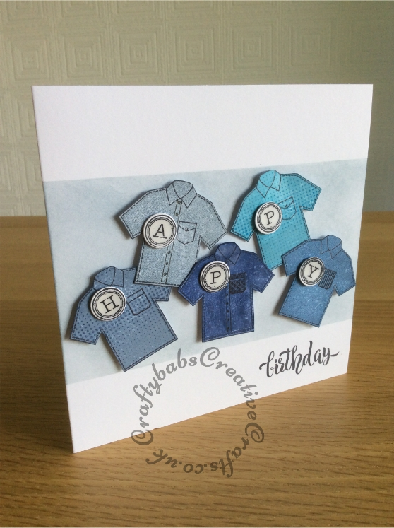 Male birthday card made using Clearly Besotted 'Super Dad' stamp set to stamp shirts which were then fussy cut. Letters stamped using Docrafts Papermania Madame Payraud's Typewriter upper case alphabet urban stamps. Background masked and inked with distress ink. - craftybabscreativecrafts.co.uk