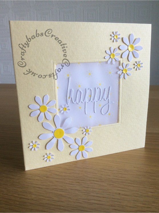 Vellum Window Happy Daisies Card made using Blank aperture card, daisy print vellum, Woodware daisy and circle punches and Sizzix Tim Holtz Thinlits Celebration Words - Script. - craftybabscreativecrafts.co.uk