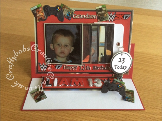 Waterfall Easel card made using photographs of the recipient and photographs of his favourite computer games, Dies used include; Sizzix Sizzlits Fruit smoothie alphabet and numbers dies, Game controller die from Yvonne Creations, nesting circles dies and Tattered Lace sentiment dies. - craftybabscreativecrafts.co.uk