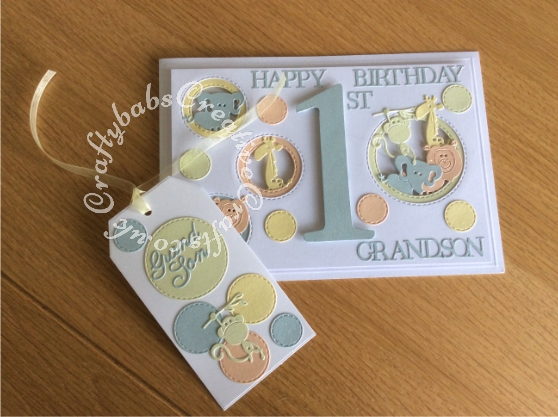 1st Birthday Card and matching gift tag made using the following dies; Sizzix Bigz Sassy Serif Numbers, Crealies Nest-Lies Double stitch circles No 33, set of 4 Cuttlebug 2x2 Zoo animals dies, sentiment from various Tattered Lace 3 Die-mensions die sets and Britannia dies Grand son sentiment dies used on tag. - craftybabscreativecrafts.co.uk