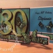 Double Z Fold 30th Birthday Card made using a variety of dies including; Memory Box Leavenworth & Cascadia Trio butterfly dies, Memory Box Darla & Vivienne Butterfly dies, 660223 Sizzix Thinlits Die Set 13PK - Celebration Words Script by Tim Holtz and 656617 Sizzix Bigz Sassy Serif Numbers. Background made using Distress oxide inks, Spectrum Noir sparkle pen and mica spray inks - craftybabscreativecrafts.co.uk