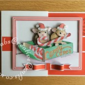 Double Z Fold Housemouse Candy Canes Decoupaged Christmas Card made using Joanna Sheen Housemouse CD Rom. Bow made using Memory box Gross Grain Ribbons dies and Britannia sentiment dies. Decoupage assembled with foam pads and highlighted with white glitter and Glossy accents - craftybabscreativecrafts.co.uk