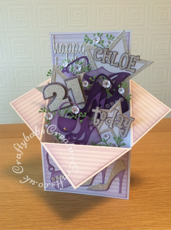 "Large Pop Up Shoes & Bags themed 21st Birthday card made from 8""x8"" card blank. Numerous dies used including; Sizzix Framelits Stars/ Primitive Die Set, Sizzix sizzlits 'Girls Are Weird' alphabet dies, Sizzix originals Shadow Box numbers, Sizzix sizzlits small purses and shoes set and shoes set, Ellison window cuts handbag, Cheery Lynn Baby's breath flower set, MCS sprig dies (from The Works) and Sentiment die cut using 660223 Sizzix Thinlits Die Set 13PK - Celebration Words Script by Tim Holtz - craftybabscreativecrafts.co.uk"