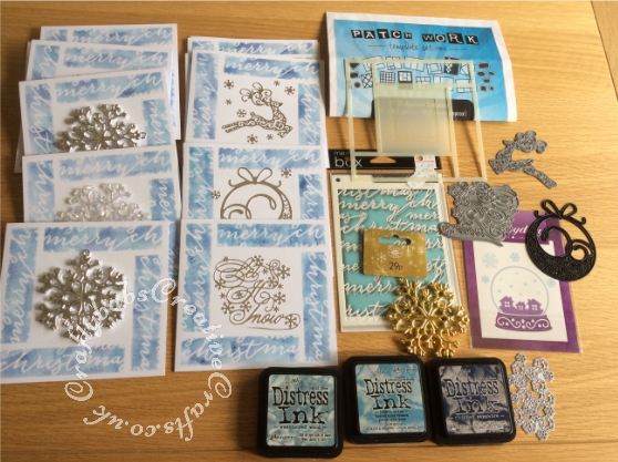 Batch making Christmas cards, made using Stamps Away Patchwork Template set One, Memory Box - A6 Stencil - Script Merry and various dies to embellish including Tattered Lace Let It Snow (D447), Tattered Lace Leaping Reindeer die, Ultimate Carfts Snowball die, and snow flakes from Hunkydory Christmas boxed kit. Some cards embellished with Christmas tree ornaments. All cards coloured by inking through stencils with various shades of blue distress inks - craftybabscreativecrafts.co.uk