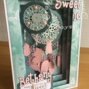 Dream Catcher Panorama Card made using a variety of dies including; Todo collection feather dies, Spellbinders Shapeabilities Dies-Feathers, Sizzix Sizzlits Alphabet 654546 Girls are weird dies, Nesting Circles dies, Nellie Snellen Multi Frame Dies - Straight Dotted Rectangle dies, Tattered Lace Doily Flourish die, Hardwick Scallop Circle (D358) die, Tattered Lace Panorama Large Inner Plates (PAN02) and Tattered Lace Panorama Large Concertina Side (PAN03) - craftybabscreativecrafts.co.uk