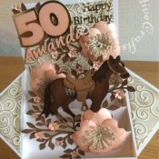 Large Pop up Box Horse themed 50th Birthay card made using various dies including; Quickutz Wildflower die set for large flowers with Cheery Lynn Designs - DIE - Build-a-Flower Embellishments # 3 die for flower stamens, Sue Wilson Finishing Touches Dies - Spring Foilage for branches and small flowers, Quickutz exclusive Remi the Horse revolution die for the horse and saddle, Sizzix Sizzlits Alphabet Script dies for name, Sizzix originals Shadow box numbers dies, Tattered Lace Sentiments 2014 (D211) dies and Britannia dies Daughter sentiment die. Sizzix Sizzlits, Dies Wester Set 38-9847 for horse shoes and Couture Creations Intrinsic Embossing Folder - craftybabscreativecrafts.co.uk