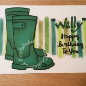 Wellington Boots Birthday card made using Sizzix Sizzlits Catty Corner alphabet dies, sentiment dies free with a crafting magazine. Background dry embossed and inked through a stencil and highlighted with microfine pen. Wellinton boots stamped onto green card using Woodware Clear Magic Wellies stamp FRS208 and shaded with peeled paint distress ink - craftybabscreativecrafts.co.uk