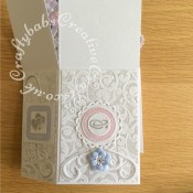 Pop up Wedding card made using a number of dies including; Spellbinders nesting plain and scalloped hearts dies, Cheery lynn flowers dies, Anna griffin flourish scroll die, spellbinders lacey circles dies, Crea Nestlies no 33 dies, leabilities frame square curve die set (for small flourishes). Joy cut & emboss wedding die set, Nellies nesting stitched squares dies, Background embossed with Hiclory Smoke distress ink applied to folder using embossaliscious a4 folder. die cuts inked with Hickory smoke distress inks, Flowers coloured with Spectrum noir sparkle pens. Tattered Lace sentiments 2014 dies and Tattered Lace Metal Die-Alpha Bunting dies for 'MEXICO'.- craftybabscreativecrafts.co.uk