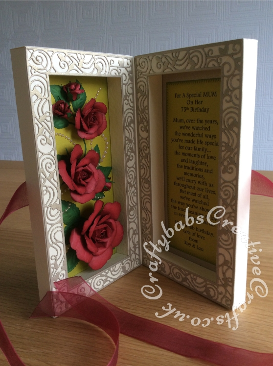 Shadow Box framed Roses 75th Birthday card made using the Tonic shadow Box Creations Die set 1635E and co-ordinating Tonic Family Three Shadowbox Insert Die (frame only) Set to make base card from 2 shadow boxes. Roses inside shadow box made using Spellbinders Rose Creations die set and tinted with distress ink. Rose embellishment on front of card made using the Free Gift rose dies from DIE-CUTTING-ESSENTIALS-MAGAZINE-ISSUE-19. Sentiments cut using Tattered Lace Sentiment dies and die'sire numbers dies - craftybabscreativecrafts.co.uk