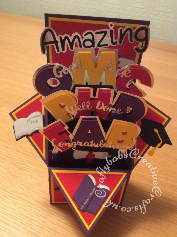 "Pop Up Box PHD Graduation card made using a variety of dies including; Sizzix Shadowbox Alphabet dies, Sentiment dies free with issue 109 of Papercrafter magazine, Crafti Potential 'Amazing' sentiment dies, and various Quickutz 2"" dies. - craftybabscreativecrafts.co.uk"
