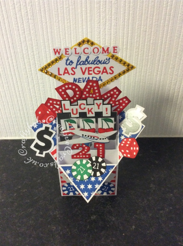 Las Vegas Themed Pop Up 21st Birthday card made using numerous dies including; Sizzix originals Shadow Box Alphabet, punctation and number dies, Sizzix sizzlits Marie Cole Design Game Set for poker chips, Sizzix - 1950s Collection - Thinlits Die - Lucky Bowling, Memory Box Alphabet Soup Capitals die (for Las Vegas), Tattered Lace Alphabet Bunting Die Set ACD197 (for welcome mounted onto circles cut with small circle die) Britannia dies alphabet (for to fabulous), Die-Versions MARKER MICRO Font Die (for Nevada), Sizzix - 1950s Collection - Thinlits Die - Rock 'n Roll Sundae set for dice and cherries and nesting diamond dies. Playing cards are from a mini set of cards I had in Christmas cracker and finally, the aeroplane was cut using the Xcut Build a scene All aboard round the world dies and coloured to match airline being used by recipient. - craftybabscreativecrafts.co.uk