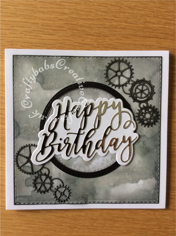 Simple Happy Birthday Card made with inked and mica sprayed background using various dies including Crealies Nest-Lies Double Stitch Circles Nesting Die Set Crea-Nest-Lies XXL 33, Crealies DOUBLE STITCH Die Set No.34 SQUARES dies, Memory Box Gearworks Border Die and Cardmaking Magic Happy Birthday sentiment die set. - craftybabscreativecrafts.co.uk