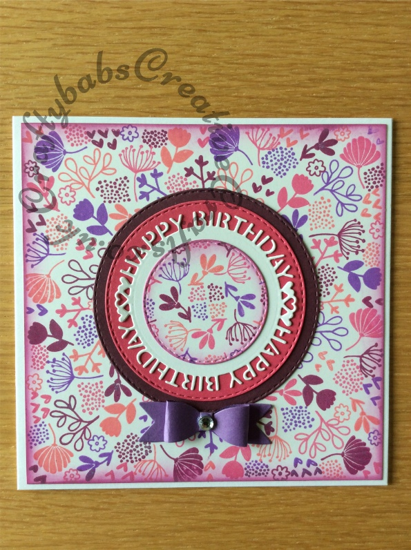 Birthday Card made using Concord & 9th Lovely Blossoms Turnabout stamp with distress oxide inks and a number of dies including; Crealies Nest-Lies Double Stitch Circles Nesting Die Set Crea-Nest-Lies XXL 33, Sue Wilson Perspectives Happy Birthday Circle Die Set and an unbranded small bow making die set. - craftybabscreativecrafts.co.uk