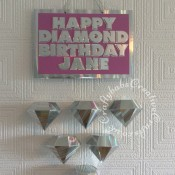 Hanging 60th Birthday plaque with suspended diamonds made using Sizzix Thinlits Plus Die Set DIAMOND BOX by Debbi Potter 661701 and Sizzix Originals Shadow Box alphabet dies. Diamonds supended from main plaque on invisible thread. - craftybabscreativecrafts.co.uk