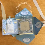 Baby Boy Birth keepsake made using a variety of dies including Marianne Design Cutting and embossing stencils Creatables - My first sneakers, Quickutz nesting Tag dies, Lettering created using Gemini Die Set Expressions Uppercase Alphabet, Gemini Die Set Expressions Lowercase Alphabet, Ellison thick cutz envelope die, Cuttlebug baby elements die, Marianne baby feet dies, Spellbinders nesting plain & scalloped oval dies, Parchment pocket made using an envelope template stencil, baby clothes and baby words embossed using brass stencils, outer cover embossed using couture creations intrinsic embossing folder. - craftybabscreativecrafts.co.uk