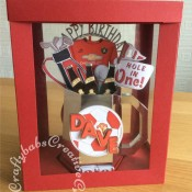 Celebration Tankard made using a template from Amethyst Paper Craft Designs CDROM Gentleman's club Tankard, decorated with die cuts using a variety of dies. including By Lene Beer Bottle Cutting & Embossing Die, Spellbinders Golf die, Marianne Design Collectables Men's Wardrobe Die, Cuttlebug Sports Balls Tag Team Disney Cuttlebug 3×3 Cut and Emboss Die set for football, Sizzix Sizzlits Fruit Smoothie Alphabet, SEntiment from The Tattered Lace Zig Zag Cascade die set and numbers dies from the Spellbinders Cargo alphabet die set. - craftybabscreativecrafts.co.uk