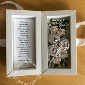 First Wedding Anniversary shadow box card made using various dies including Tonic Shadow Box Creations die set, Heartfelt creations Majestic Blooms Die, Cheery Lynn Baby's breath flower die, Memory box Norrland flower dies, Altenew Garden Picks die set, Alt-e-new Layered Rose die set, free with issue 174 of Simply Cards & Papercraft magazine and Britannia Sentiment dies. - craftybabscreativecrafts.co.uk